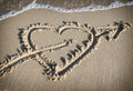 Heart with an arrow drawn on the sand Royalty Free Stock Photo