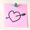Heart with arrow on paper post it Royalty Free Stock Photo