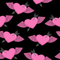 Heart and arrow symbol of love. Winged heart seamless pattern. B Royalty Free Stock Photo