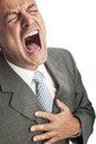 Heart attack of a businessman Stock Photos