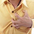 Heart attack use hand grabbing a chest with white background Royalty Free Stock Images
