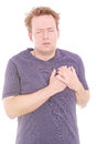 Heart attack young man holding his aching chest as a concept for heartache isolated on white Royalty Free Stock Photos