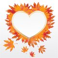 Autumn leaves heart background with golden frame