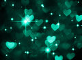 Heart background boke photo, dark cyan color. Abstract holiday, celebration and valentine backdrop. Royalty Free Stock Photo