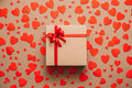 Heart background. Valentines day. Abstract paper hearts and gift box with red ribbon. Royalty Free Stock Photo