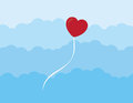 Heart balloon floating through the clouds Stock Photo