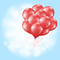 Heart balloons flying on light blue Stock Images