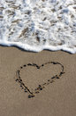 Heart on beach sand background Royalty Free Stock Photography