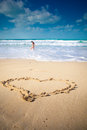 The heart on beach sand blue sea Stock Photography