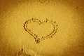 The heart on beach sand yellow Stock Image