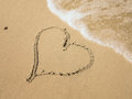 Heart on beach shape drawn in sand a Stock Image