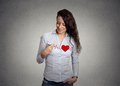 Heart beat. Woman drawing a heart on her shirt Royalty Free Stock Photo