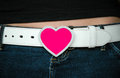 Heart belt buckle a on a white worn by a female showing a little midriff Stock Photo