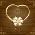 Heart and bow on wooden background valentines with golden greetings ornate elements illustration Stock Photo