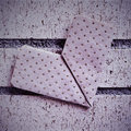 Heart on a brick wall an origami with retro effect Stock Image