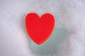 Heart in a bubble bath cleansers Royalty Free Stock Photo