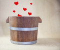 Heart in bucket hearts drop wooden Stock Images