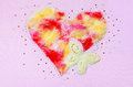 Heart butterfly fluff and sequin decoration on a pink fabric background Stock Photos