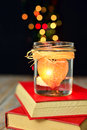 Heart candle and books dreams love light red bokeh light background concept of stories unusual Stock Photos