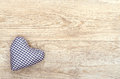 Heart of cloth blue checked on old wood Royalty Free Stock Image