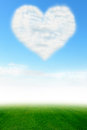 Heart cloud on blue sky and green field Royalty Free Stock Photo