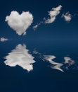 Heart cloud and reflection in water Stock Image