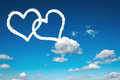 Heart clouds shape on the clear blue sky Royalty Free Stock Image