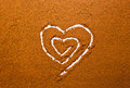 Heart cocoa powder on a background Stock Photography