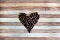 Heart Of Coffe Beans On Wooden...