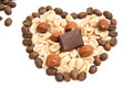 Heart of coffee beans, chocolate, peanuts and hazelnuts