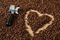 Heart in coffee beans with porta filter Royalty Free Stock Photo
