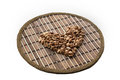 Heart of coffee beans on a round matting isolated Royalty Free Stock Image