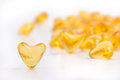 Heart color pills of fish oil Royalty Free Stock Photo