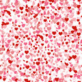 Heart confetti seamless pattern for Valentines day, falling on white background. Pink and red symbols of love for Women