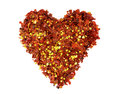 Heart of crushed red chili pepper in shape isolated on a white background Stock Photography