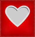 Heart cutout in red card on grey Royalty Free Stock Photo