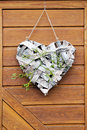 Heart deco on door made of tree bark with mistletoe branch Royalty Free Stock Images
