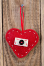 Heart decoration hanging against wooden background Royalty Free Stock Images