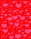 Heart digital scrapbook paper pink hearts of varying sizes on red background Stock Photography