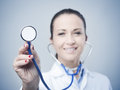 Heart diseases prevention and assistance female smiling doctor with stethoscope concept Stock Photos