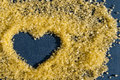 Heart drawing on an impressive surface of salt for Spa therapies. Structure of sea salt Royalty Free Stock Photo