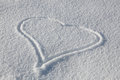 Heart Drawn In Fresh Snow Stock Photos