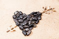 Heart drawn with pebbles on the sand Royalty Free Stock Photo
