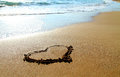 Heart drawn in the sand on beach Royalty Free Stock Photography