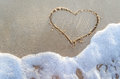 Heart drawn on a sand of beach Royalty Free Stock Photo