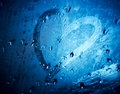 Heart drawn on wet glass. Royalty Free Stock Images