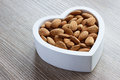 Heart filled with almonds Royalty Free Stock Photo