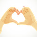 Heart folded from beautiful female hands isolated on white background Royalty Free Stock Image