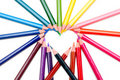 Heart form the color pencils on white background Royalty Free Stock Images