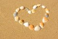 Heart frame made of sea shells Royalty Free Stock Photo